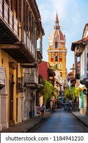 The colorful Cathedral of Cartagena towering above the typical buildings in the historic centre of Cartagena, Colombia, on a sunny day.