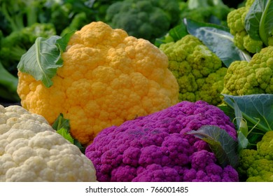 Colorful Cauliflowers on the counter in farmer market.