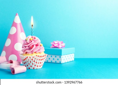 Colorful celebration background with various party decoration and cupcake. Minimal party concept.