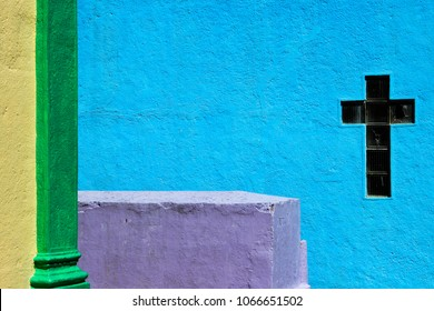 Colorful cemetery with green, purple and blue colors, Christian Cross
