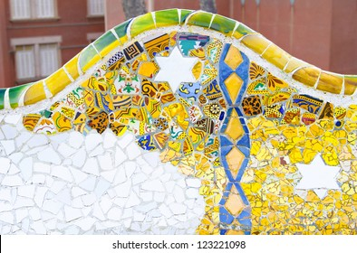 Colorful ceramic bench details at the Parc Guell designed by Antoni Gaudi, Barcelona, Spain.
