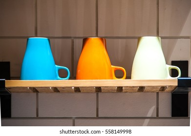 Colorful ceramic cubs on the wooden shelf.