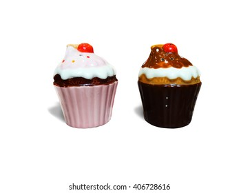 Colorful ceramic cupcake-shaped salt and pepper shaker isolated on white background with clipping path.