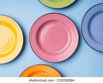Colorful ceramic dishes. Flat lay tableware set concept