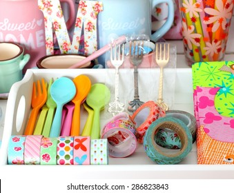 Colorful ceramic and melamine cutlery and dishware in pastel colors
