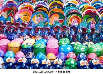 Colorful ceramic objects for sale in a market in Mexico