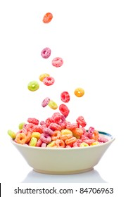 Colorful cereal falling on a bowl on a white background