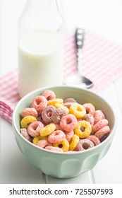 Colorful cereal rings and milk.