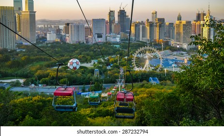 Colorful chairlifts and cityscape of Dalian, China
