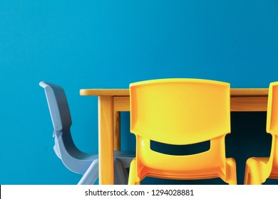 colorful chairs in a classroom with a minimal design