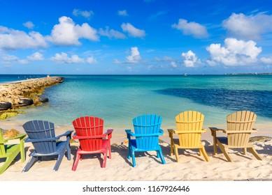 Colorful chairs near the shore of the beautiful Eagle Beach in Aruba
