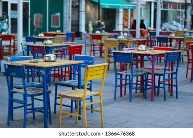 Colorful Chairs and Tables. Colored Chairs in a Turkish Cafe. Bistro Tables. Tea Shop with beautiful Seats and Tables on the Street.