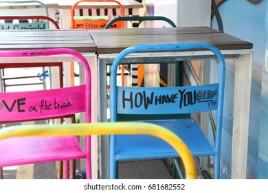 Colorful chairs with text at Haji lane, Singapore