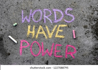 Colorful chalk drawing on asphalt: text WORDS HAVE POWER