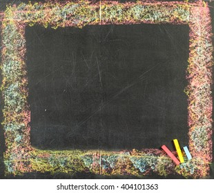 Colorful chalk frame on school blackboard