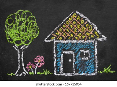 Colorful chalk illustration of home by kid on blackboard