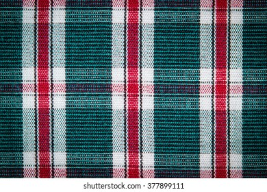 Colorful checkered shirt as background texture, multicolored fabric as backdrop