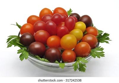 Colorful cherry tomatoes isolated on white background  . Grape tomato. Plum tomato.