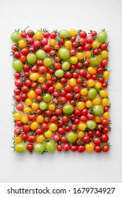 colorful cherry tomatoes on the white background