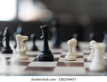 colorful chess figureson a blurred background
