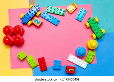 Colorful child kid's education toys pattern background copy space on the bright background. Childhood infancy children babies concept
