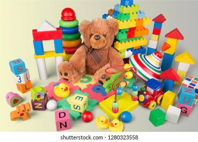 Colorful children building bricks on background