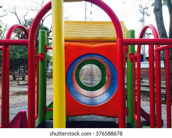 Colorful children toy house in the public playground. For kids to play and relax
