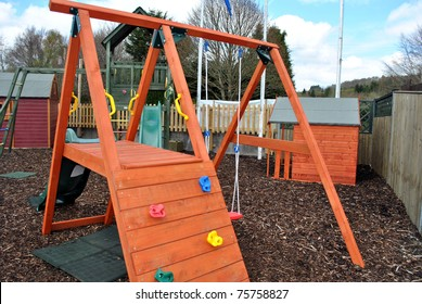 colorful childrens playground with wooden equipment