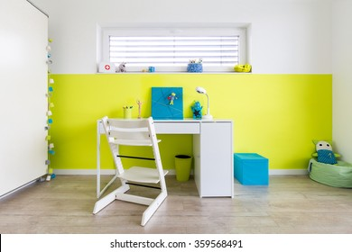 Colorful Children's Playroom with Desk and a green wall