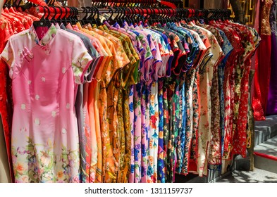 Colorful chinese cheongsam hanging for sale during Chinese New Year.