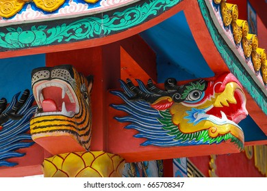 colorful Chinese dragon in clear above the shrine at Pattani,