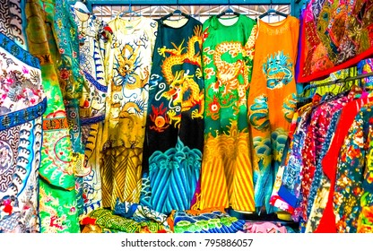 Colorful Chinese Dragon Replica Silk Garments Robes Panjuan Flea Market  Decorations Beijing China.  Panjuan Flea Curio market has many fakes, replicas and copies of older Chinese products.