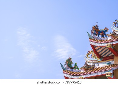 Colorful Chinese Kirin and chinese dragon fish statue decorate on the roof of Chinese Temple, Chinese Shrine, Joss house
