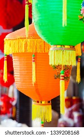 Colorful Chinese paper lanterns hanging in a street martket prepared for Chinese spring festival