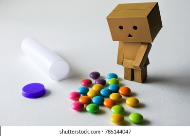 Colorful chocolate buttons on white background. Someone addicted to its bitter sweet flavor and some people like to give it to their lover on Valentines Day.