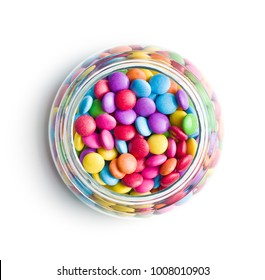 Colorful chocolate candies in jar isolated on white background.