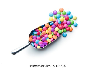 Colorful chocolate candies in scoop isolated on white background.