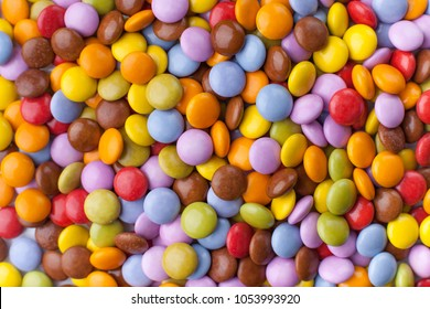 A lot of colorful chocolate candy. Close up top view, occupying the whole picture.