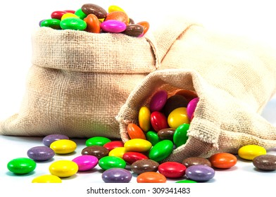 Colorful chocolate candy in mini sack bag on white background