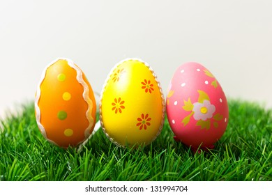 Colorful chocolate easter eggs on green grass