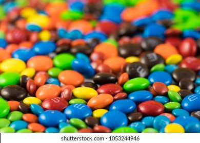 Colorful chocolate M&Ms in and out of focus