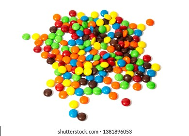 Colorful chocolate in and out of focus on white background