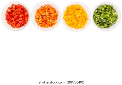 Colorful chopped capsicums in white bowls over white background