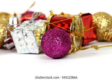 Colorful Christmas balls and gift packages on a white background