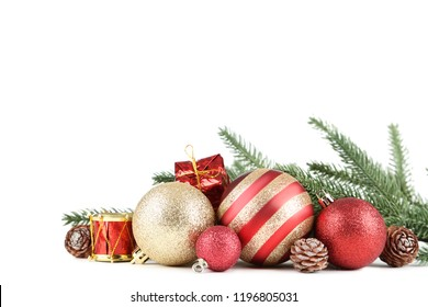 Colorful christmas baubles with fir tree branches on white background
