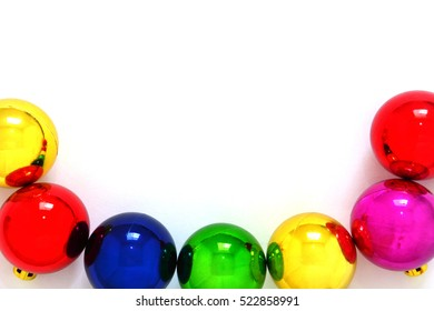 colorful Christmas decoration ball on white background, copy space