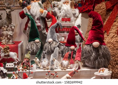 Colorful Christmas decoration containing a lot of dwarfs, Santa Clause, reindeers, moose.