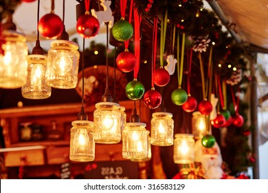 Colorful Christmas decorations and glass lanterns on a Parisian Christmas market