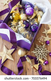 Colorful christmas decorations and ornaments in box