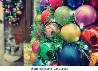 Colorful Christmas decorations in a store on the street. Image filtered in faded, retro, Instagram style with soft focus; nostalgic vintage concept of winter holidays.